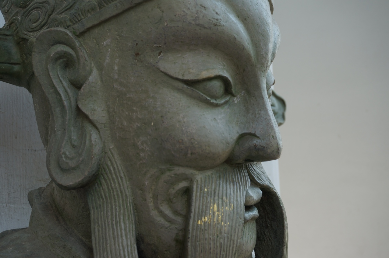 Love the gold flakes on his mustache - Wat Pho